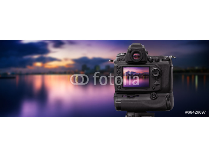 Dslr camera shooting cityscape at sunset 64238
