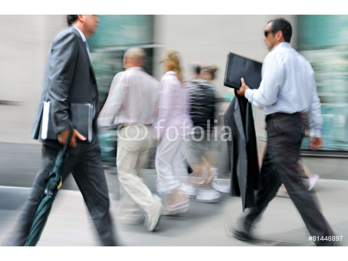 motion blurred business people walking on the street 64238