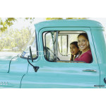 Hispanic mother and daughter driving truck 64238