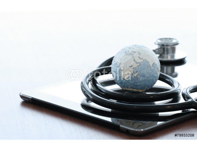 Studio macro of a stethoscope and texture globe with digital tab 64238