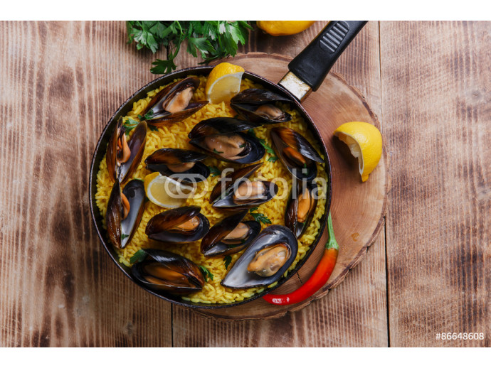 mussel paella rice in a frying pan 64238