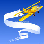 Vintage yellow airplane with a banner 64238