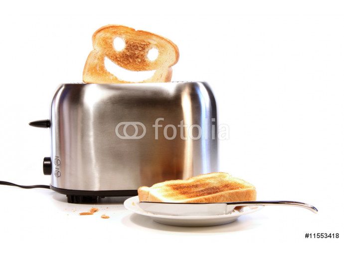 Toasted bread with toaster on white 64238