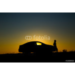 Silhouette of sedan car with girl on the background of beautiful sunset 64238
