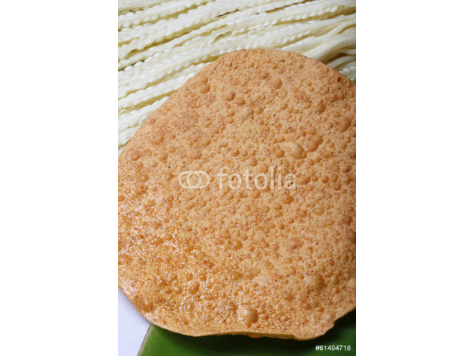 Papad is a popular Indian snack or round flat bread 64238