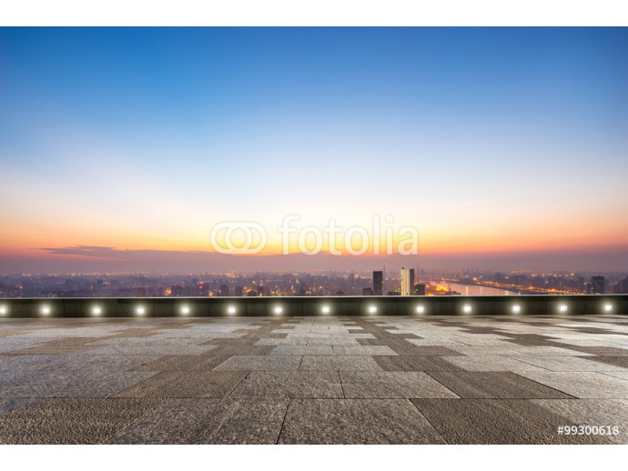 empty floor front of cityscape at sunrise 64238
