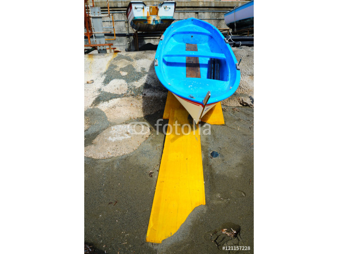 colorful fishing wooden boat moored on the beach 64238