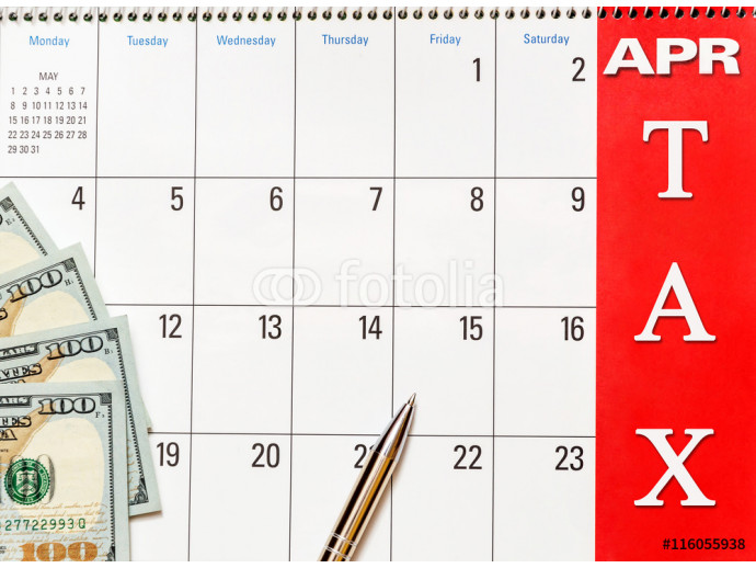 "Dollars on the calendar with the words ""tax"" 64238"