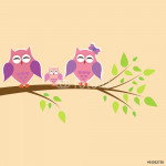 happy family of owls sitting on a tree branch 64238