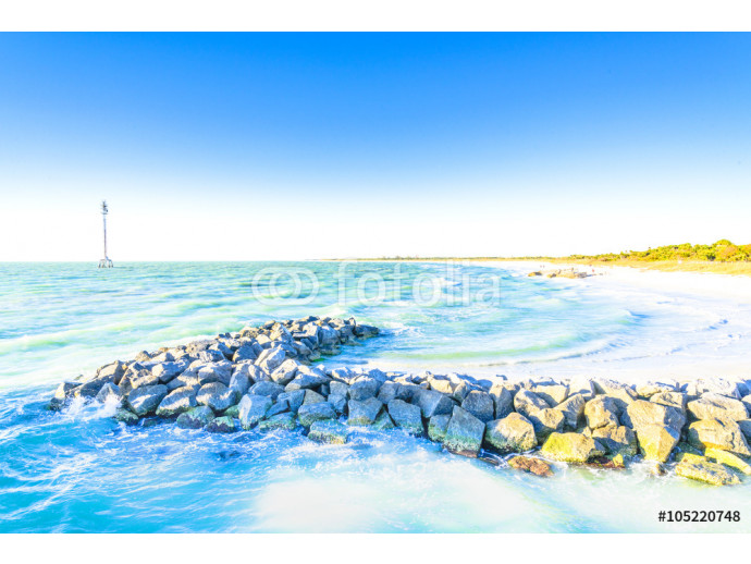 Rocks on the ocean and blue sky background 64238