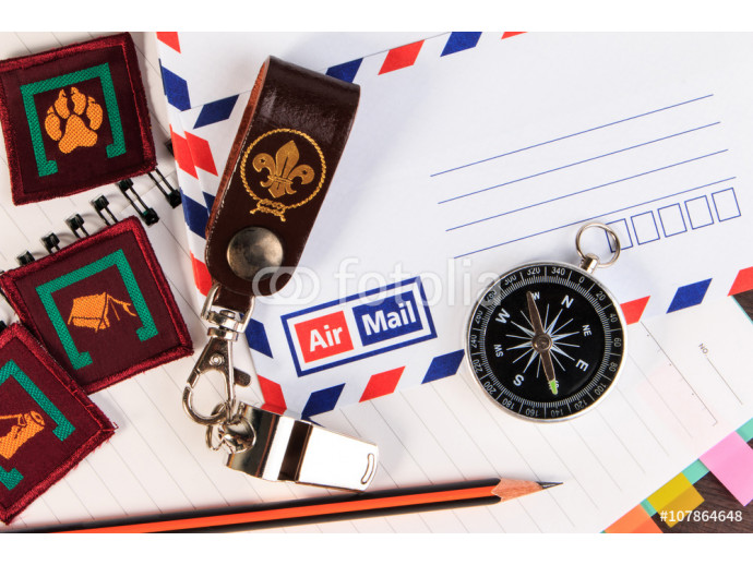 Metal whistle with leather keychain, compass, badge on envelopes 64238
