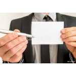 Businessman holding out a blank card and pen 64238