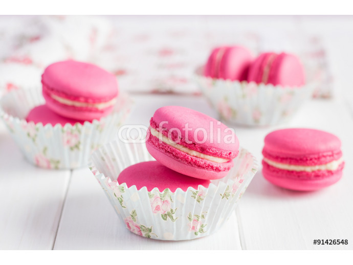 Pink raspberry macaroons on white wooden background 64238