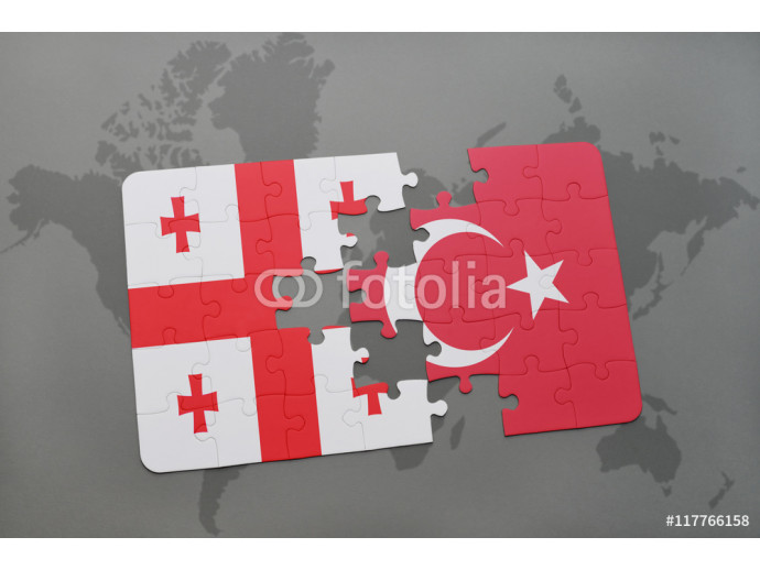 puzzle with the national flag of georgia and turkey on a world map background. 64238