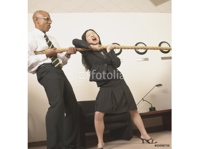 Business people pulling rope in office 64238