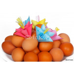 Easter eggs on the plate with a paper flower 64238