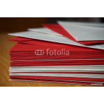 Packet of red and silver (pearly) envelopes prepared for the written announcement note 64238