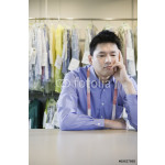 Bored Asian dry cleaner 64238