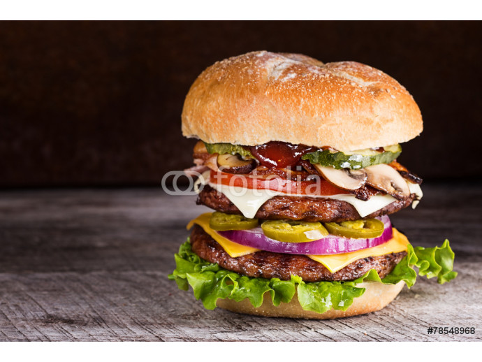 Double patty hamburger with a variety of ingredients 64238