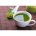 Green tea matcha in a cup on the brown mat 64238