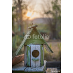 close up old wooden bird house in garden with twilight backgroun 64238