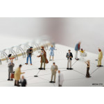 close up of miniature people with social network diagram on open 64238