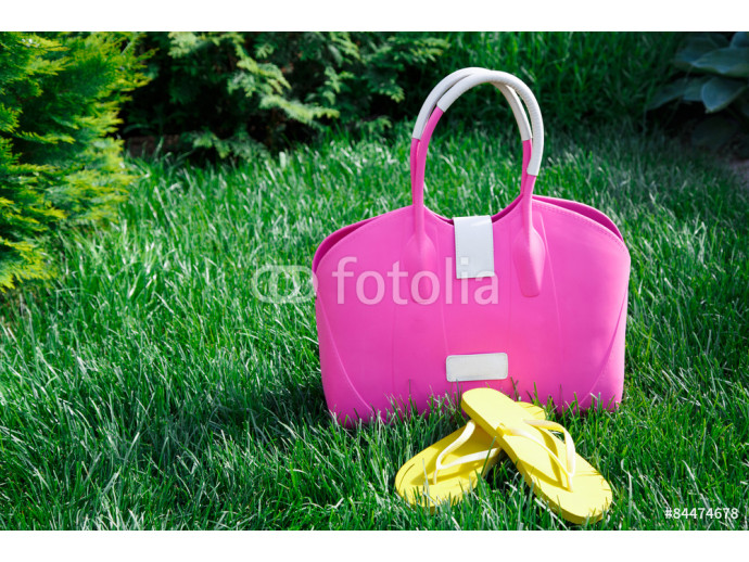 front view of pink purse on green grass 64238