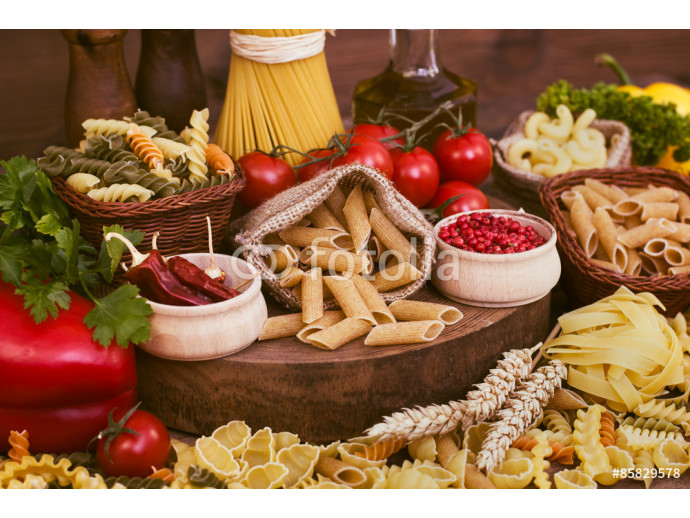 Variety of uncooked pasta and vegetables  64238
