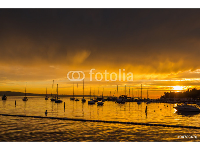 Boats parked near the beach in the rays of a beautiful sunset. 64238