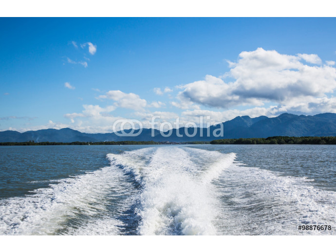 wake of a passenger ship with blue sky and clouds 64238