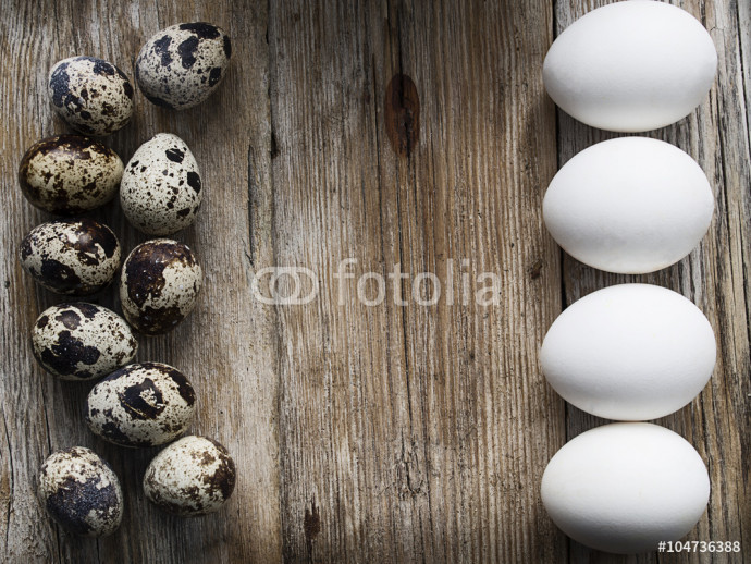 Easter eggs on wood board background with space for copy, text 64238