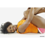 Portrait of woman laying down with arms wrapped around knees 64238
