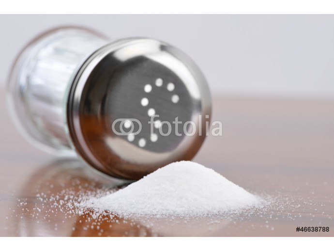 Salt spilling from glass salt shaker 64238