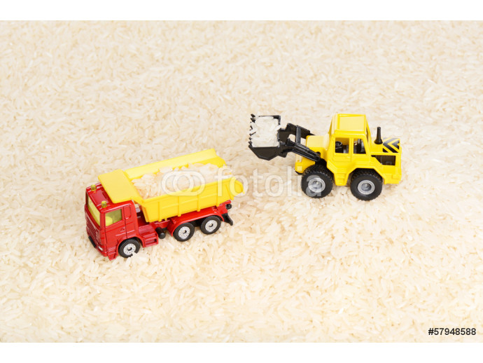 Fototapeta Industrial tractor toy load rice seeds to dump truck 64238