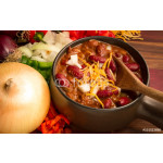 Spicy Bowl Of Chili. Hot bowl of fresh chili with cheese, onions, and peppers. 64238