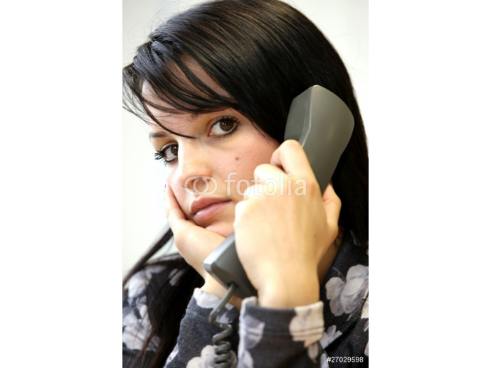 Fototapeta Young Woman Using Telephone. Model Released 64238