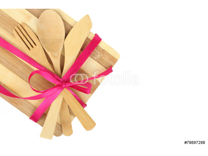 Cooking background - cutlery on cutting board tied with ribbon 64238