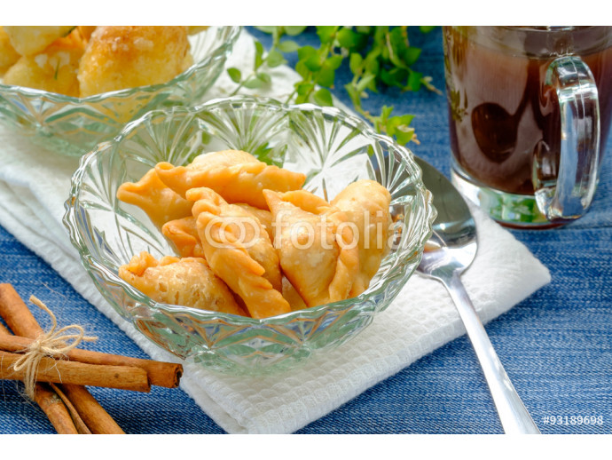 Fried dessert balls covered with sugar and onion 64238
