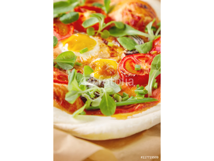 Home Italian pizza with tomato and quail eggs salad on a baking 64238