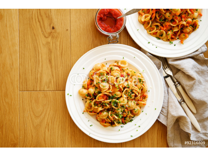 Traditional Italian pasta orecchiette with tomato sauce and vegetables  64238