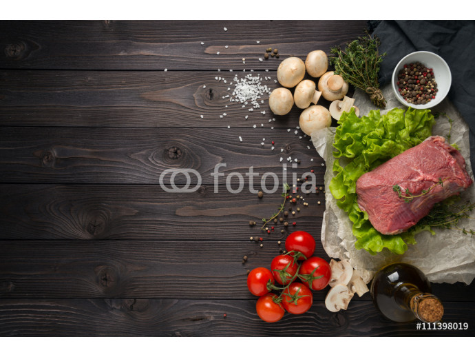 raw meat with ingredients on a wooden background 64238