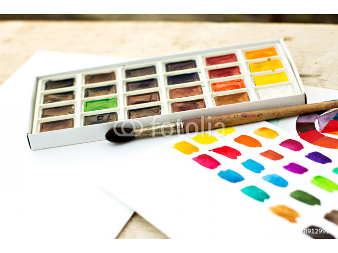 Workplace artist - paper, paint, brushes, color wheel. 64238