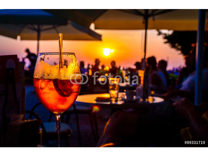 Photo wallpaper Orange ice cold cocktail in a beach bar at the sunset 64238
