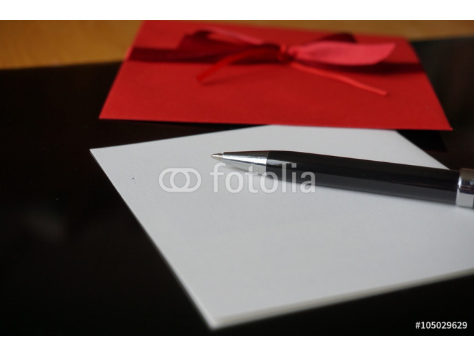 Black pen writing announcement letter with the decorated red envelope 64238