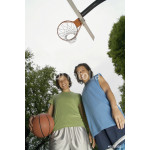 Low angle portrait of two teenage girls with basketball on court 64238