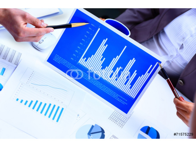 Financial paper charts and graphs on the table 64238