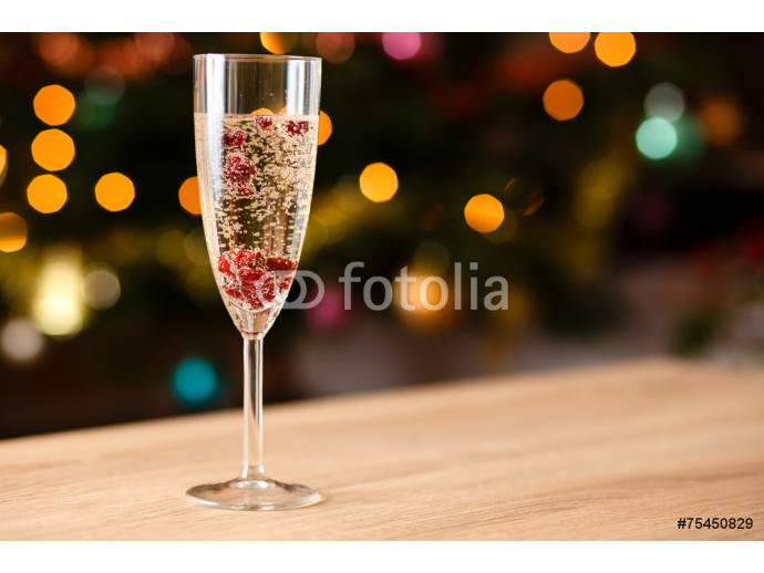 Glass full of champagne with cranberries 64238