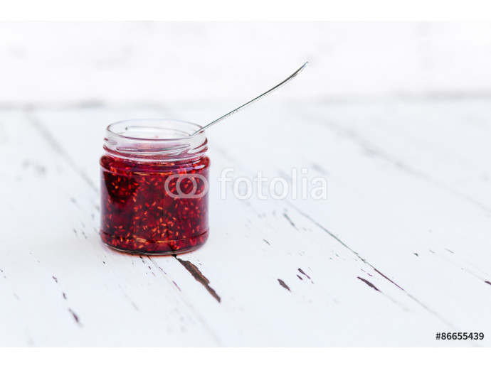 Raspberry jam in a jar on the wooden table 64238