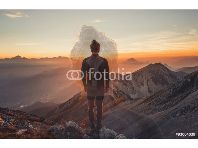 Male hiker observing the sunset at the top of the local big mountain. The photograph was taken in Karavanke mountain range in Slovenia. 64238