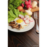Fried egg on the plate with vegetables 64238